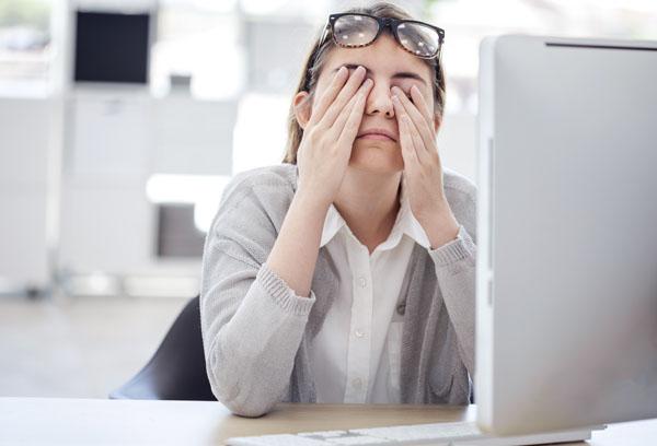 Woman rubbing her eyes
